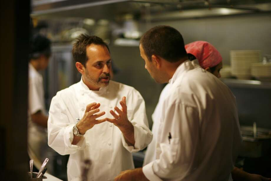 Craig Stoll (left), chef and owner of Delfina, working in the kitchen