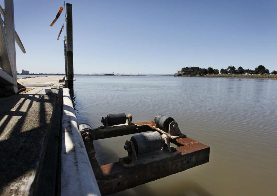 A piling is missing from a damaged pier that\'s closed to public use at the Berkeley Marina in Berkeley, Calif. on Tuesday, April 16, 2013. The wooden pole had rotted away and broke off last November, prompting the closure of the pier.