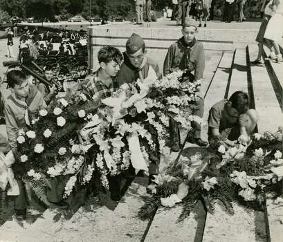 April 21, 1947: Boy Scouts placed wreaths honoring the men who died 111 years ago at San Jacinto and the men, women and children who died last week at Texas City, on the steps of the San Jacinto monument Monday afternoon. Left to right, the boys are, Dick Morgan, Edwin Donaho, Ralph Stevenson, Gary Armitage and George Parr, all of Troop 19. Photo: Bill Nottingham, Houston Chronicle / Houston Post files