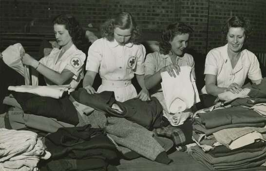 April 17, 1947: Four volunteer Red Cross workers are shown above as they sorted donated clothing for Texas City disaster victims at the City Auditorium Thursday afternoon. Left to right, are: Miss Barbara Daniel, Miss Evelyn Bateman, Miss Betty Wayne Thacker and Miss Hattie Fleming. Photo: Houston Chronicle Files / Houston Chronicle