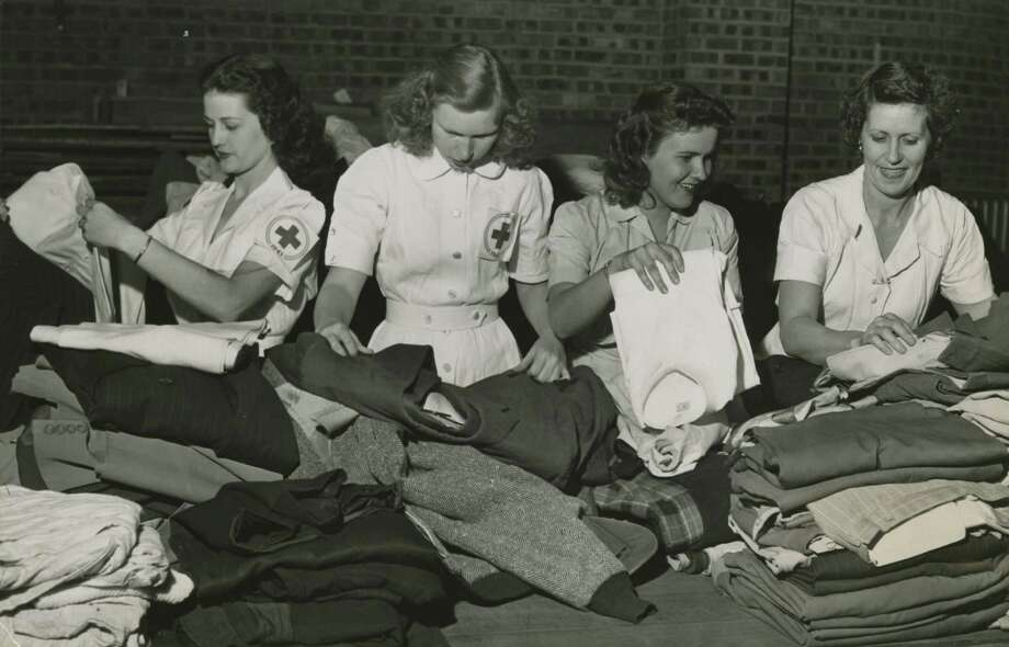 04/17/1947 - Texas City Disaster Red Cross relief collection at City Auditorium in Houston - Red Cross volunteers sort donated clothes. (L-R): Barbara Daniel, Evelyn Bateman, Betty Wayne Thacker and Hattie Fleming. staff / Houston Chronicle Photo: Houston Chronicle Files / Houston Chronicle
