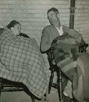 April 17, 1947: Barbara Jean Wade is shown with her uncle, B. L. Hendrick, employe of Ford, Bacon & Davis Construction Company, as they slept beside the high school gymnasium while awaiting a ride to Houston. Photo: ., Houston Chronicle Files / Houston Chronicle