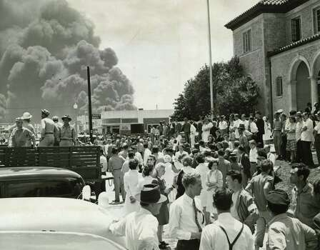 Undated: Hundreds of anxious people crowd the sidewalks outside the Texas City Auditorium as they await possible word of missing relatives. The auditorium was early set up as an aid station for those lightly wounded in the blast and a general clearing house of information. Photo: Chester Rogers, Houston Chronicle / Houston Chronicle