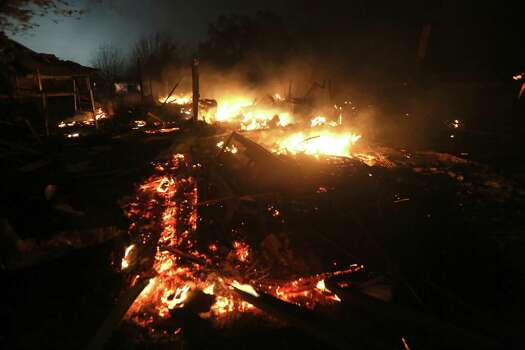 The remains of a home burn early Thursday morning, April 18, 2013, after a fertilizer plant exploded Wednesday night in West, Texas. The massive explosion killed as many as 15 people and injured more than 160, shaking the ground with the strength of a small earthquake and leveling homes and businesses for blocks in every direction. (AP Photo/LM Otero) Photo: LM Otero, Associated Press / AP