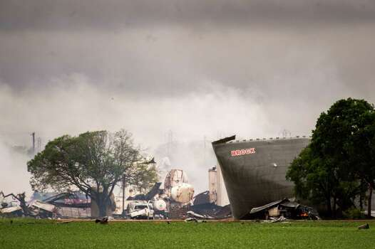 The remains of the the West Fertilizer Co. plant smolder in the rain on Thursday, April 18, 2013, in West, Texas.  A massive explosion at the plant killed as many as 15 people and injured more than 160, officials said overnight.   (AP Photo/Houston Chronicle,  Smiley N. Pool) MANDATORY CREDIT Photo: Smiley N. Pool, Associated Press / Houston Chronicle