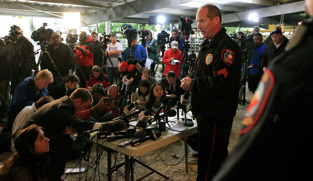 Waco Police Sgt. William Swanton (center) speaks during a press conference on the explosion at a fertilizer plant Thursday April 18, 2013 in West, Tx. Photo: Edward A. Ornelas, Express-News / © 2013 San Antonio Express-News