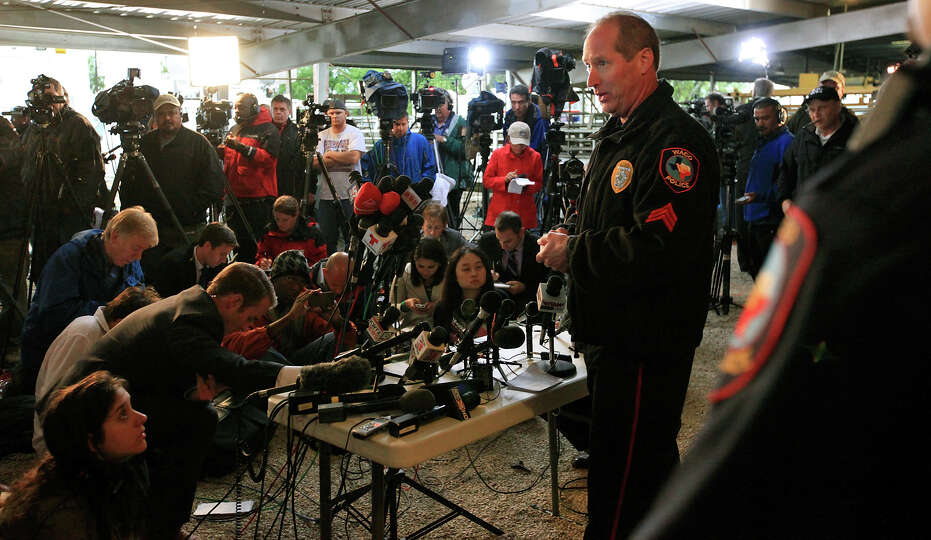 Waco Police Sgt. William Swanton (center) speaks during a press conference on the explosion at a fer