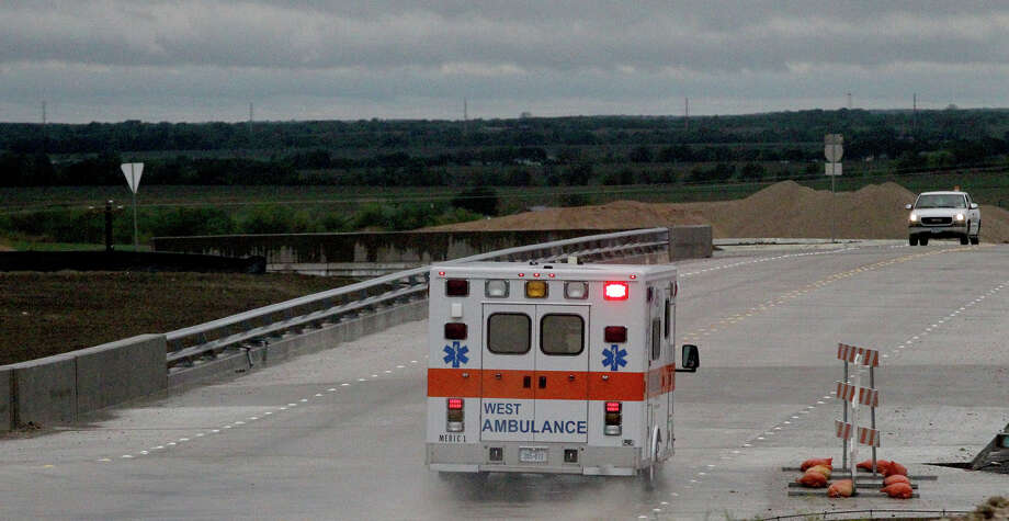 An ambulance leaves Thursday April 18, 2013 at the area where a fertilizer blew up near the town of West, Texas. Photo: JOHN DAVENPORT, Express-News / ©San Antonio Express-News/Photo may be sold to the public