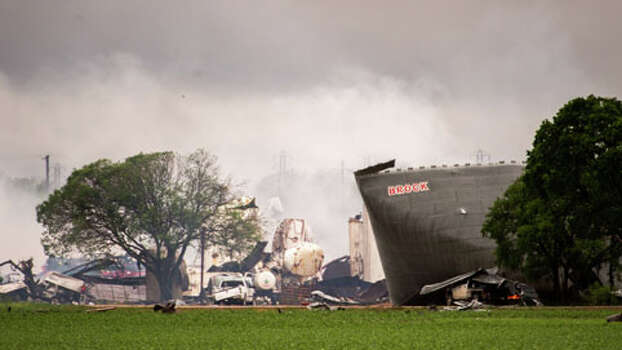 The remains of the the West Fertilizer Co. plant smolder in the rain on Thursday, April 18, 2013, in West, Texas.  A massive explosion at the plant killed as many as 15 people and injured more than 160, officials said overnight.   (AP Photo/Houston Chronicle,  Smiley N. Pool) MANDATORY CREDIT Photo: Smiley N. Pool, . / Houston Chronicle