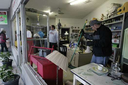 Bobby Rios, right, cleans up shattered windows at a store in West, Texas, on Thursday, April 18, 2013. Much of the small town suffered damage when a fertilizer plant caught fire causing a massive explosion Wednesday night. Authorities are still trying to determine the death and injury toll. (Ron T. Ennis/Fort Worth Star-Telegram/MCT) Photo: McClatchy-Tribune News Service