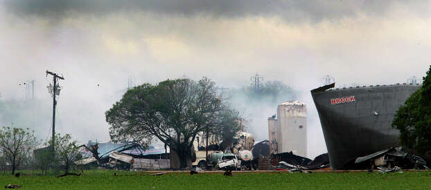 Smoke rises Thursday April 18, 2013 from an area where an explosion took place at a fertilizer plant near the Town of West, Texas. West is near Waco, Texas. Photo: John Davenport/Express-News