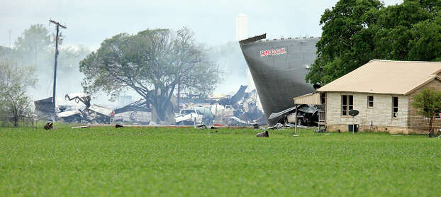 The smoldering remains, Thursday April 18, 2013, of a fertilizer plant that exploded Wednesday evening in West, Tx. Photo: Edward A. Ornelas, San Antonio Express-News / © 2013 San Antonio Express-News