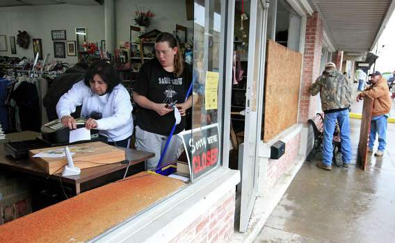 West Thrift Shop manager Maria Galvan (left) and Anissa Adamson clean the shop as workers board up windows, Thursday April 18, 2013, at  after an explosion at a fertilizer plant Wednesday evening in West, Tx. Photo: Edward A. Ornelas, San Antonio Express-News / © 2013 San Antonio Express-News