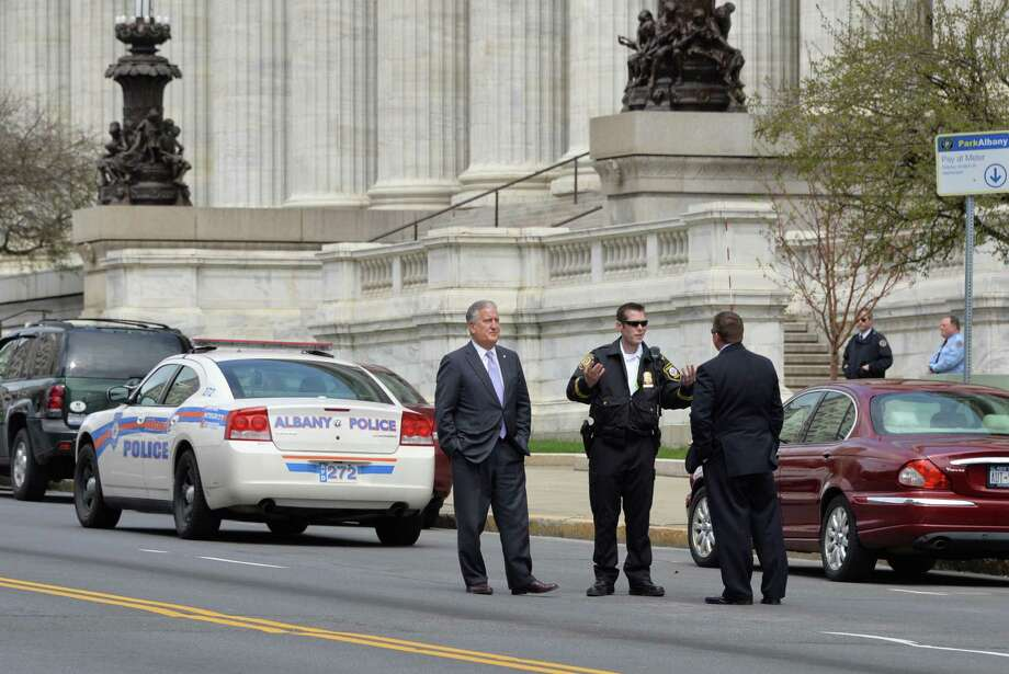 Albany Mayor Jerry Jennings, left, meets with police as they cordon off a section of Washington Ave. in Albany, NY in front of the State Education building after a report of a suspicious package there Thursday April 18, 2013.  (John Carl D'Annibale / Times Union) Photo: John Carl D'Annibale