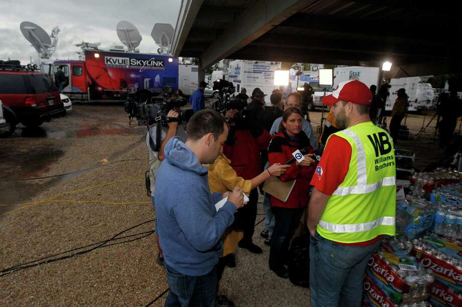 West resident Wesley Adcock, 29, talks to the media near the site of a massive explosion at a fertilizer plant in West, Texas on April 17, 2013.  (Michael Ainsworth/The Dallas Morning News) Photo: Michael Ainsworth, Staff Photographer / 10017144A