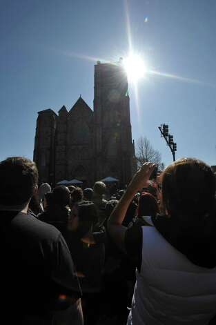 People gather outside of the Cathedral of the Holy Cross as US President Barrack Obama and wife Michelle attend an interfaith prayer service to honor the victims of the Boston Marathon bombings April 18, 2013 in the South End neighborhood of Boston, Massachusetts. Photo: STAN HONDA, Getty Images / 2013 AFP
