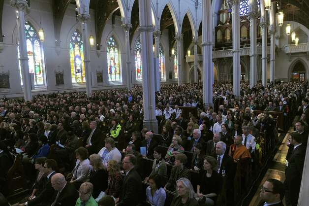 "People attend the ""Healing Our City: An Interfaith Service"" dedicated to those who were gravely wounded or killed in the Boston Marathon bombing, at the Cathedral of the Holy Cross in Boston, Massachusetts, on April 18, 2013. Obama heads to Boston to mourn victims of the deadly marathon attacks, as investigators study images of a suspect who may have planted the bombs. No arrests have been made in connection with Monday's twin bombings near the finish line of the race, which sent metal fragments and nails into a crowd of thousands of runners and spectators, killing three people and wounding 180. Photo: JEWEL SAMAD, Getty Images / 2013 AFP"