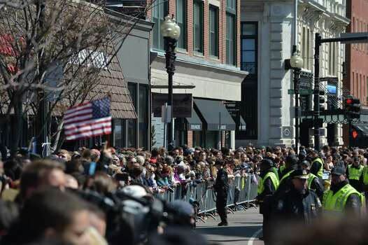 People gather outside of the Cathedral of the Holy Cross as US President Barrack Obama and wife Michelle attend an interfaith prayer service to honor the victims of the Boston Marathon bombings April 18, 2013 in the South End neighborhood of Boston, Massachusetts. Photo: Getty Images