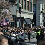 People gather outside of the Cathedral of the Holy Cross as US President Barrack Obama and wife Michelle attend an interfaith prayer service to honor the victims of the Boston Marathon bombings April 18, 2013 in the South End neighborhood of Boston, Massachusetts.