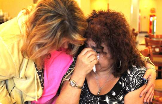 Janie Salazar, right, 57, of West weeps as she is held by her friend Iesha Chapman,46, of Waco at the Best Western in West. Salazar, had to evacuate from her home after the blast. Photo: Johhny Hanson/ Houston Chronicle