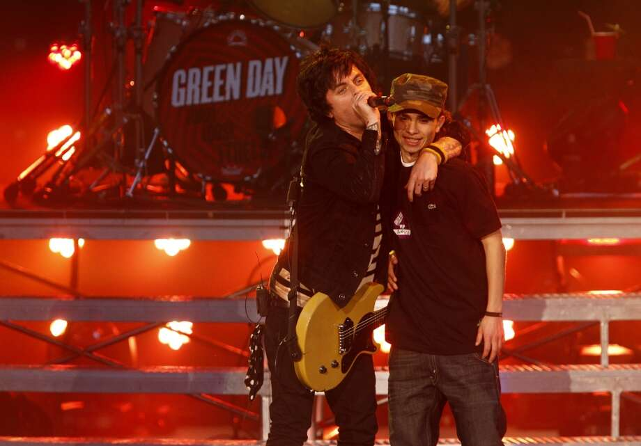 Green Day, led by Billie Joe Armstrong, played a homecoming show at Berkeley\'s Greek Theatre on Tuesday, April 16, 2013, in Berkeley, Calif. He invited his nephew up on stage for part of the opening song.