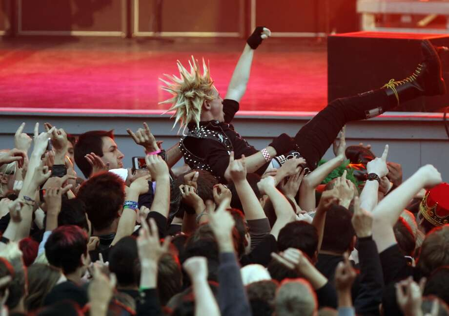 A fan crowd surfs as Green Day, led by Billie Joe Armstrong, played a homecoming show at Berkeley\'s Greek Theatre on Tuesday, April 16, 2013, in Berkeley, Calif.