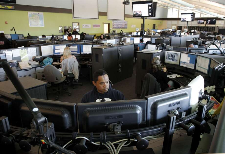 Edgar Velasco, a dispatcher for the last eleven years joins colleagues who are busy taking emergency calls at main dispatch center inside the Emergency management building in San Francisco, Ca., on Thursday April 11, 2013.