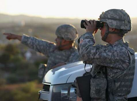 John Moore/Getty Images. National Guard at Texas border
