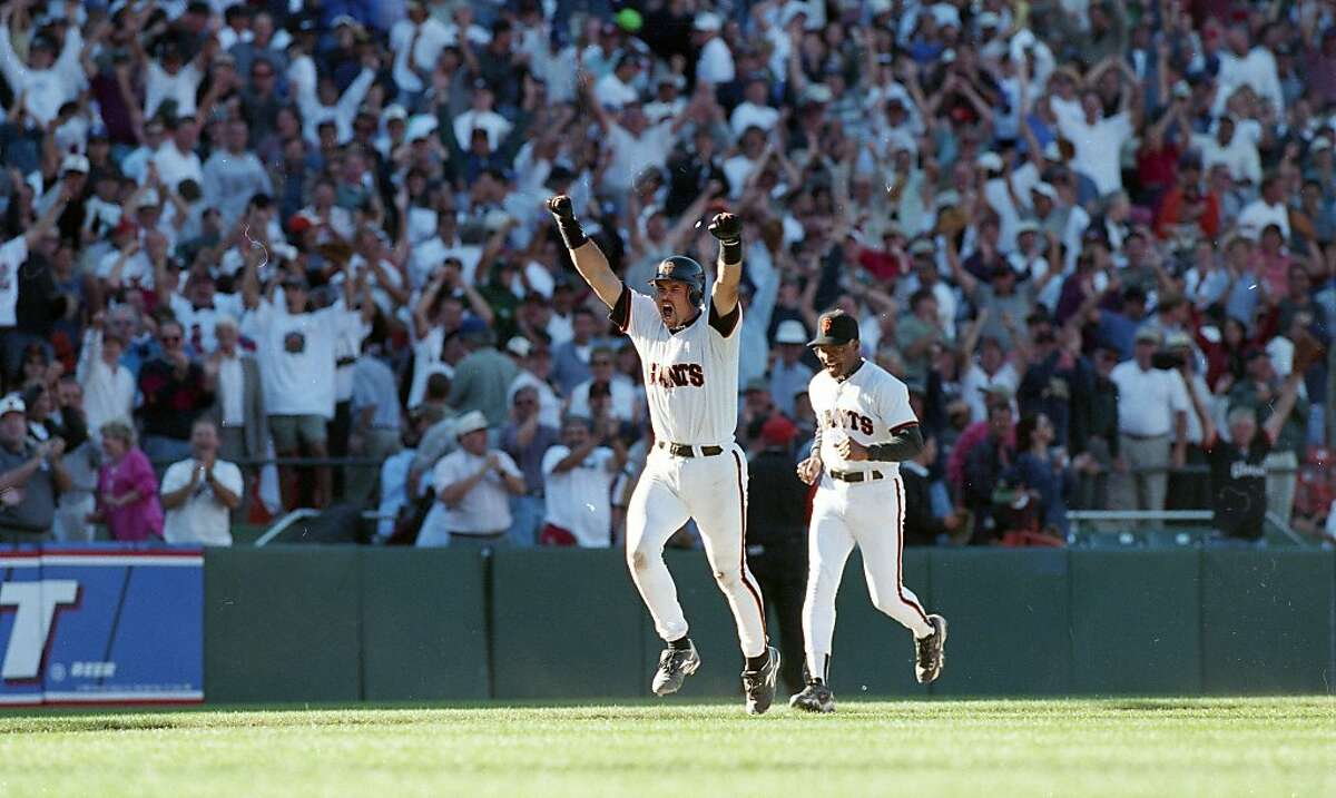 Brian Johnson is chased around third base by coach Sonny Jackson during a game against the Los Angeles Dodgers on September 18, 1997 in San Francisco, Calif. The Giants won the extra-innings game in the 12th.