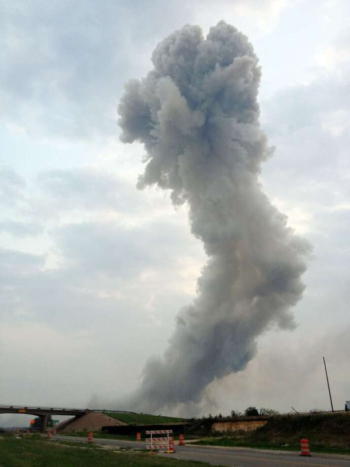 In this Wednesday, April 17, 2013, photo provided by Joe Berti, a plume of smoke rises from a fertilizer plant fire near Waco, Texas.  A massive explosion at the West Fertilizer Co. killed as many as 15 people and injured more than 160, officials said Thursday morning. (AP Photo/Joe Berti) Photo: Associated Press / AP