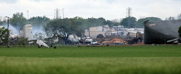The smoldering remains, Thursday April 18, 2013, of a fertilizer plant that exploded Wednesday evening in West, Tx. Photo: Edward A. Ornelas, Edward A. Ornelas/Express-News / © 2013 San Antonio Express-News