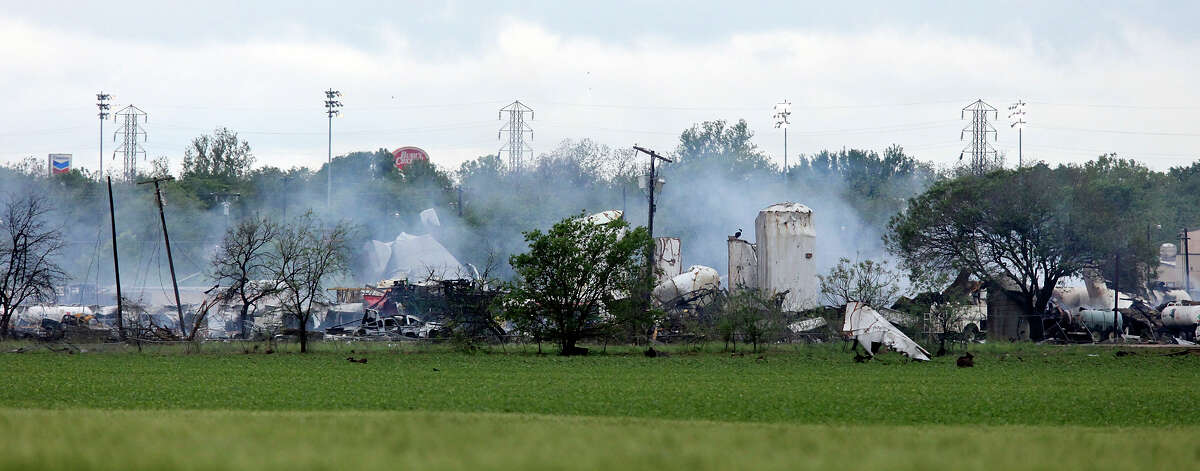 The smoldering remains, Thursday April 18, 2013, of a fertilizer plant that exploded Wednesday evening in West, Tx.