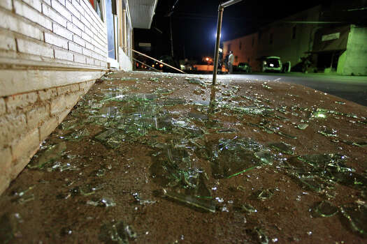 Shattered windows on a sidewalk after an explosion at a fertilizer plant Thursday April 18, 2013 in West, Tx. Photo: Edward A. Ornelas, San Antonio Express-News / © 2013 San Antonio Express-News