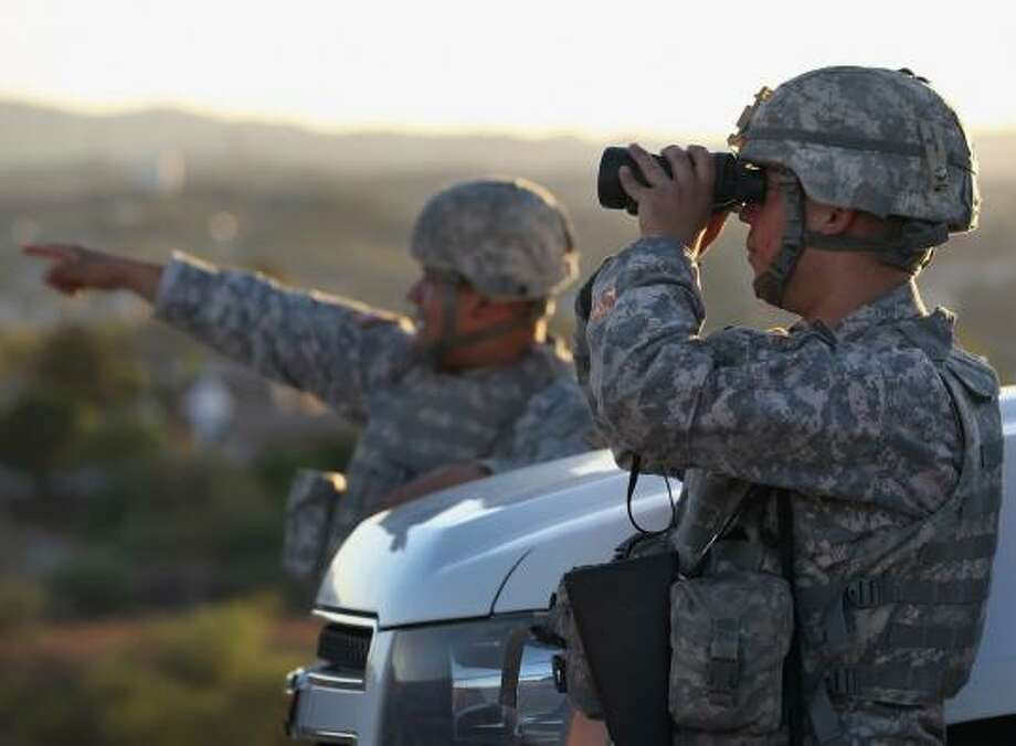 John Moore/Getty Images. National Guard at Texas border