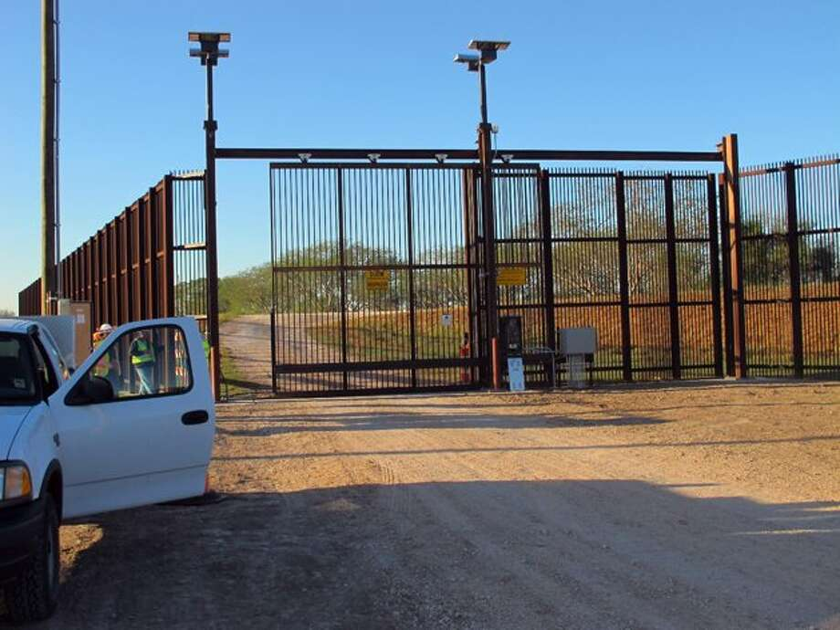 AP/Chris Sherman. Border fence in Brownsville, TX.