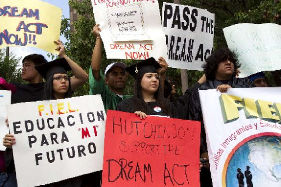 Brett Coomer/Houston Chronicle. Protesters supporting the DREAM Act.