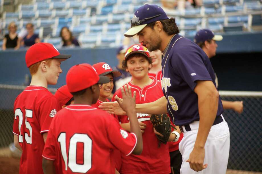 "This film image released by Provident Films/Samuel Goldwyn Films shows Scott Elrod, right, in a scene from ""Home Run."" (AP Photo/Provident Films/Samuel Goldwyn Films)"