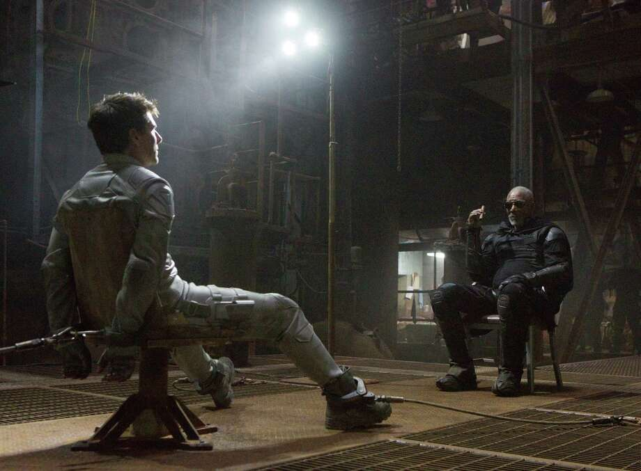 "This film publicity image released by Universal Pictures shows Tom Cruise, left, and Morgan Freeman in a scene from ""Oblivion."" (AP Photo/Universal Pictures) Photo: David James"