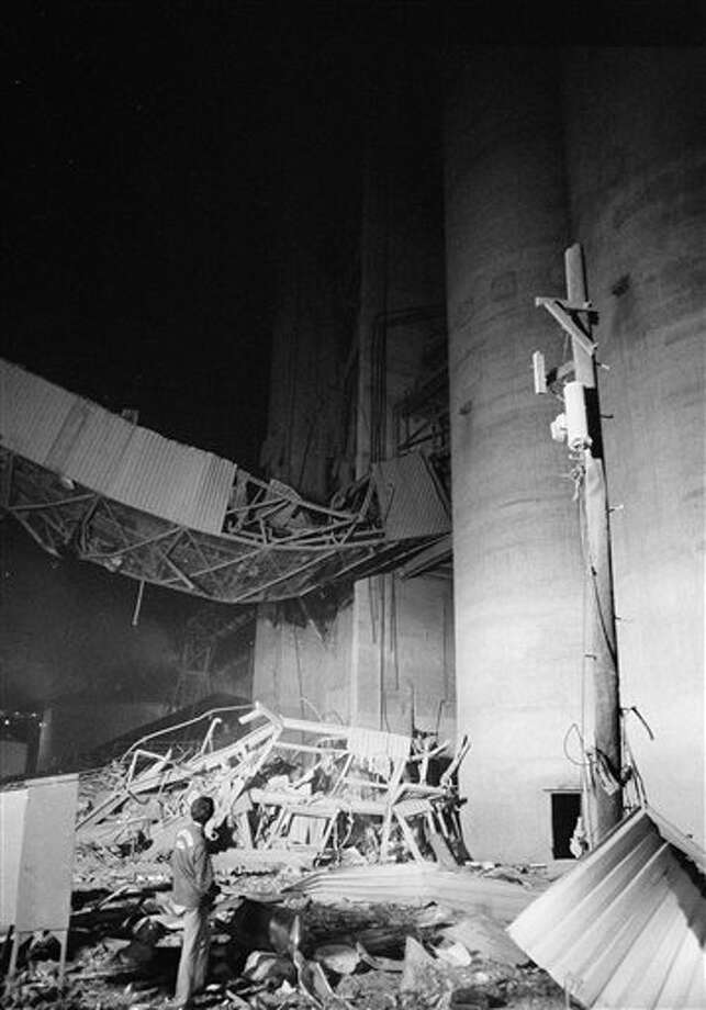 Dec. 27, 1977: Spark causes flash fire at the Farmer's Export Co. grain elevator  on the Galveston docks killing 18 people. Photo: Ed Kolenovsky, Associated Press / 1977 AP