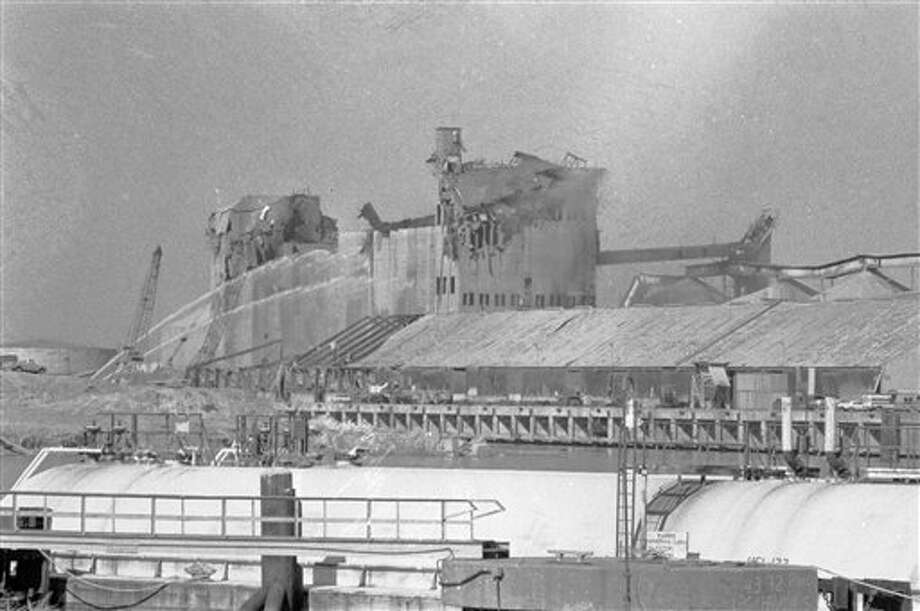 Feb. 22, 1976: Explosion and fire at the Goodpasture Inc. grain elevator on the Houston Ship Channel kills nine. Photo: Tom Colburn, Associated Press / AP1976