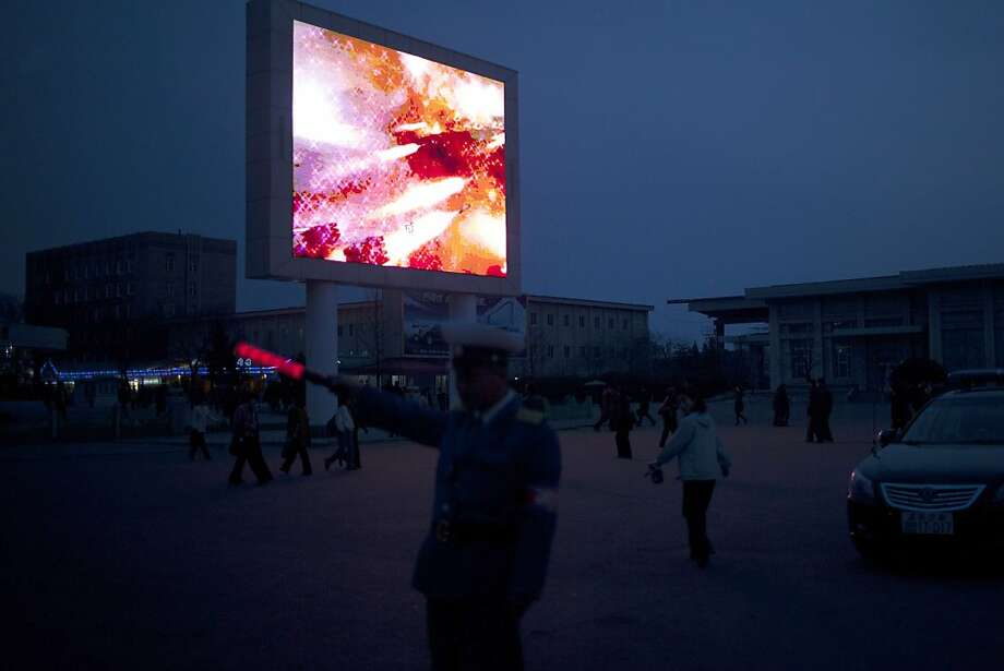 Now playing - 'Our Glorious Missiles Rain Down on the Imperialist Dogs': In Pyongyang, North Korea, a traffic cop directs cars by a big-screen TV that shows only the Propaganda Channel. Photo: Alexander F. Yuan, Associated Press