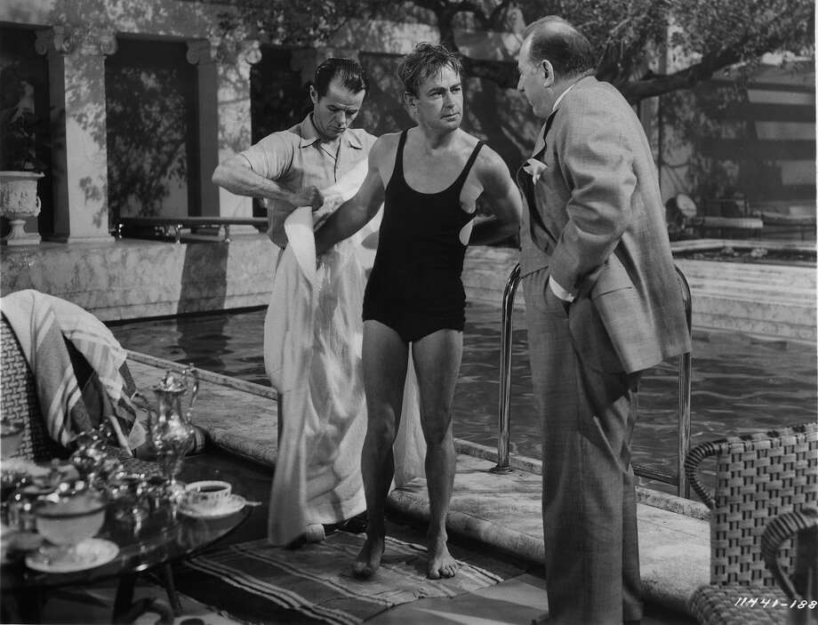 Alan Ladd is approached after getting out of pool in a scene from the film 'The Great Gatsby', 1949. Photo: Archive Photos, Getty Images / 2012 Getty Images
