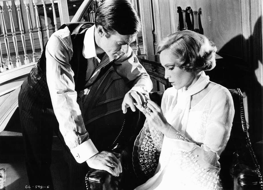 Mia Farrow putting ring on the finger of Robert Redford in a scene from the film 'The Great Gatsby', 1974. Photo: Archive Photos, Getty Images / 2012 Getty Images