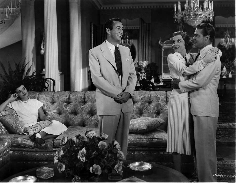 MacDonald Carey looking at Alan Ladd who's holding an unidentified woman in a scene from the film 'The Great Gatsby', 1949. Photo: Archive Photos, Getty Images / 2011 Getty Images