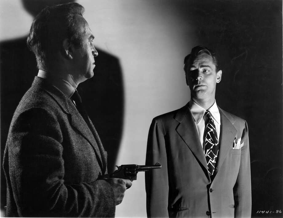 Unidentified actor points gun at Alan Ladd in a scene from the film 'The Great Gatsby', 1949. Photo: Archive Photos, Getty Images / 2011 Getty Images