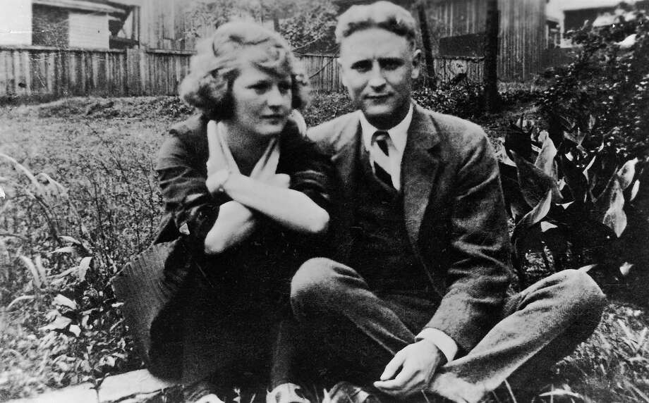Family album snapshot of American novelist Francis Scott Key Fitzgerald and wife Zelda sitting outside on lawn at her mother's home. Photo: Time Life Pictures, Getty Images / Time Life Pictures
