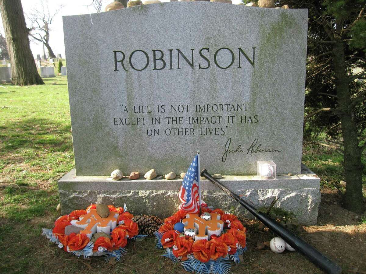 Fans still leave tributes at Jackie Robinson's gravesite at Cypress Hills Cemetery in Brooklyn.