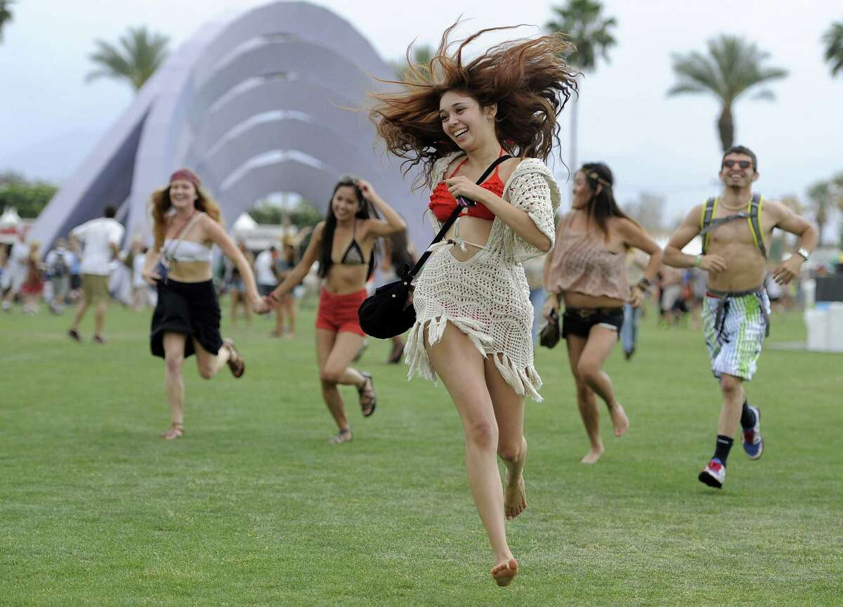 Festival-goers run toward the main stage to catch the beginning of Kendrick Lamar's set during the first weekend of the 2012 Coachella Valley Music and Arts Festival in Indio, Calif.