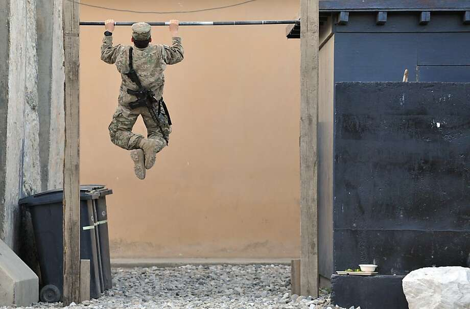 Pull-ups before chow-down: A soldier works out before dinner at Forward Base Honaker Miracle in Afghanistan's Kunar province. Photo: Manjunath Kiran, AFP/Getty Images