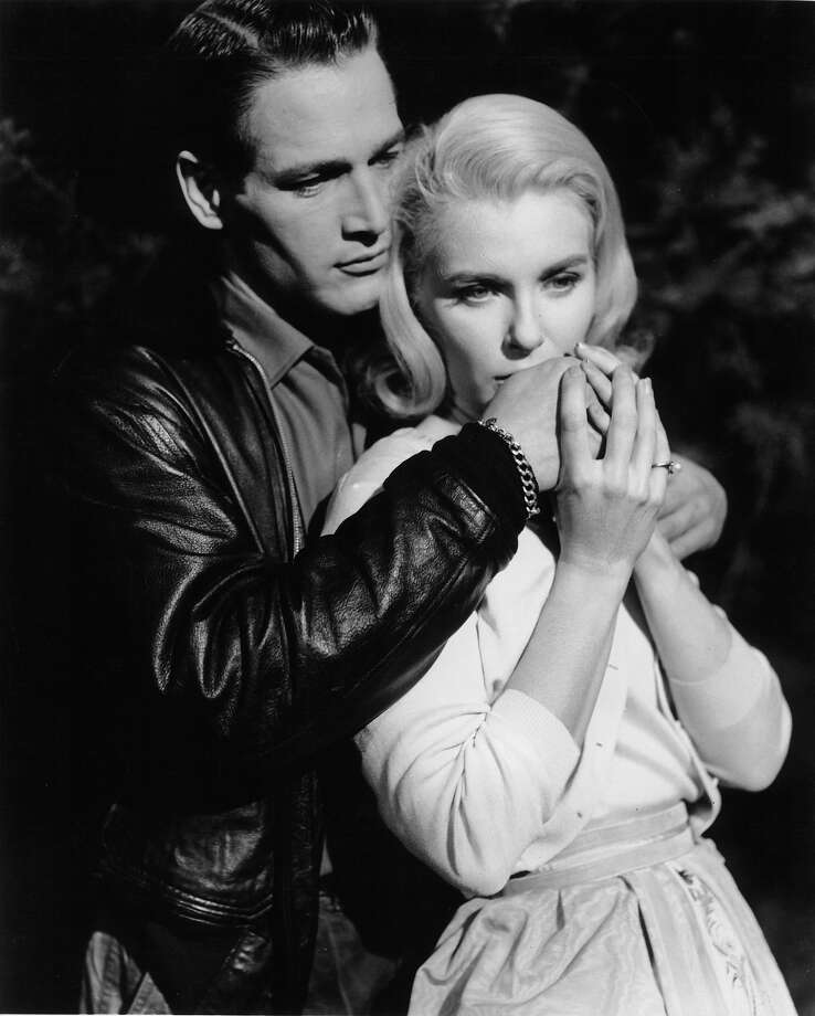Paul Newman holding Joanne Woodward in a scene from the film 'From The Terrace', 1960. Photo: Archive Photos, Getty Images / 2012 Getty Images